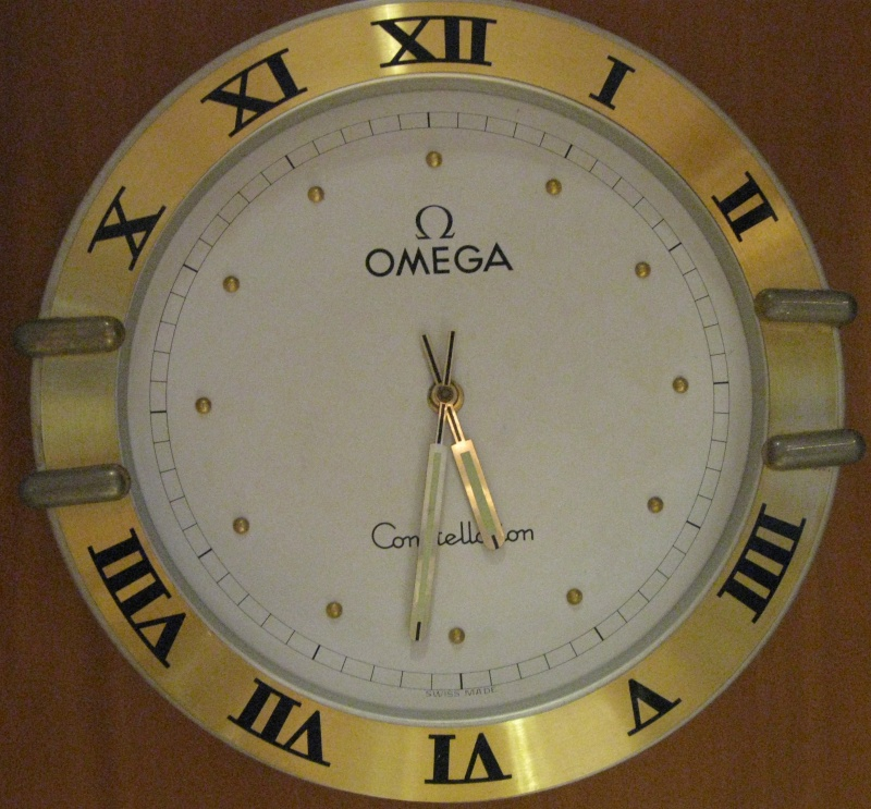 o trouver une horloge murale publicitaire omega rolex heuer etc page 14. Black Bedroom Furniture Sets. Home Design Ideas